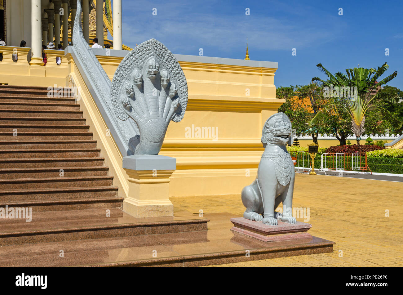 Cambodian seven-headed naga and a lion at the Royal Palace in Phnom Penh, depicted as guardian statues at the steps of the Throne Hall, symbolise the  - Stock Image