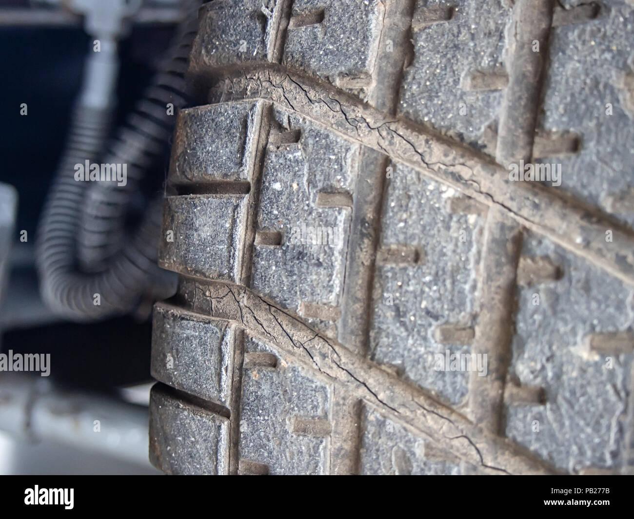 Bad tread of a tire closeup - Stock Image