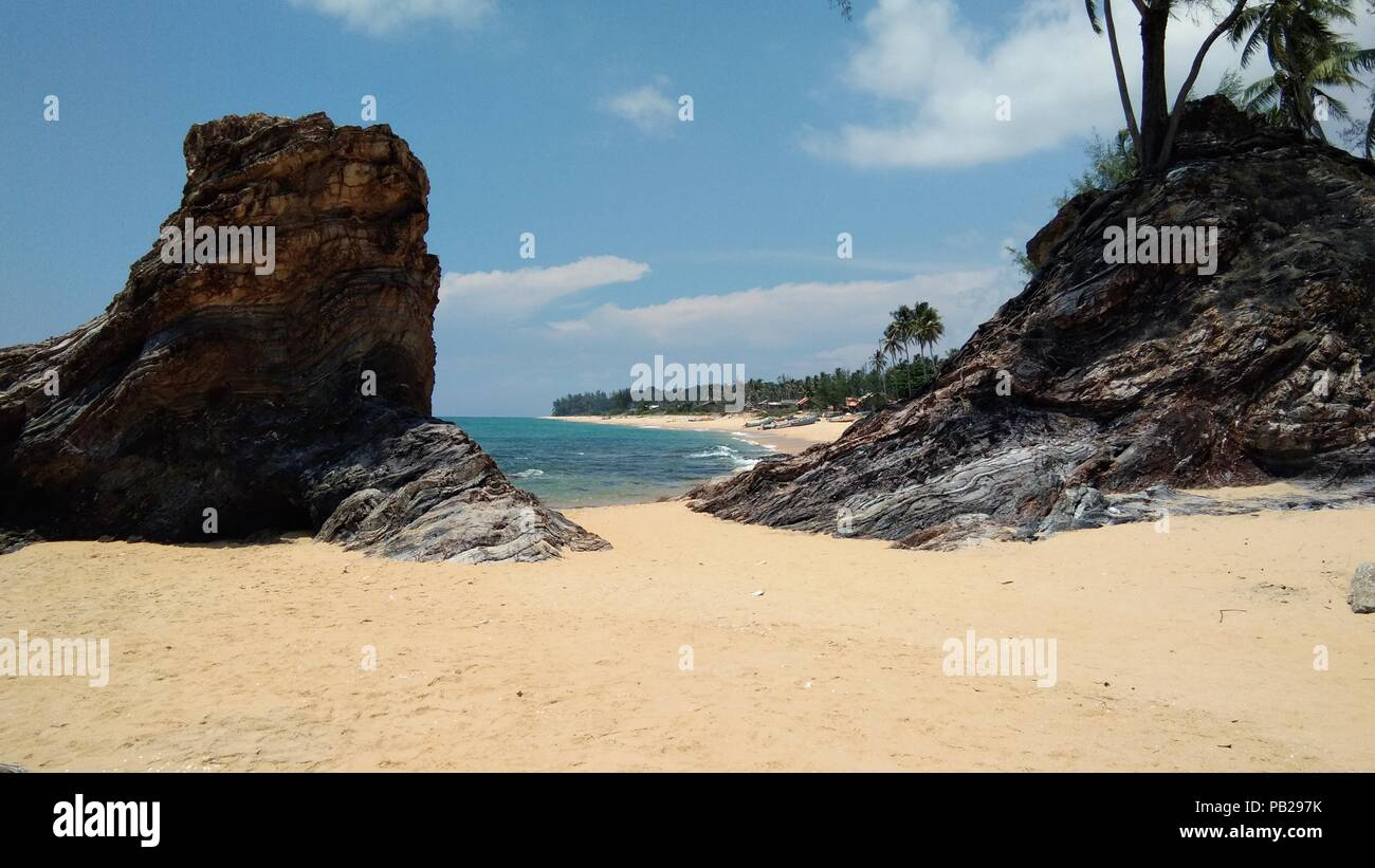 a big stone at Kuala Abang beach, Malaysia - Stock Image