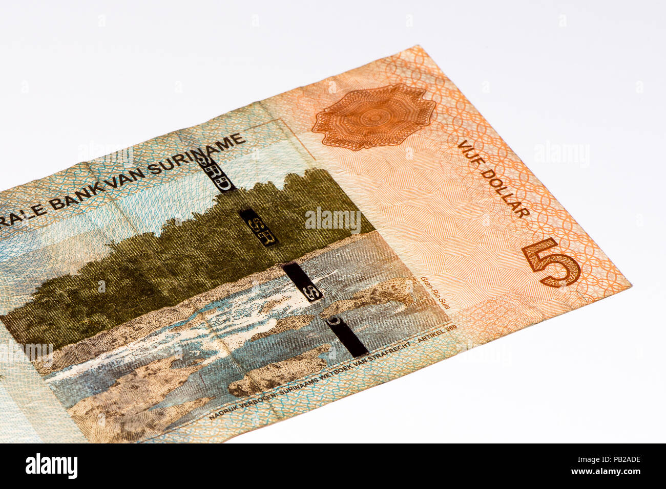 5 Surinamese dollar bank note. Surinamese dollar is the national currency of Suriname - Stock Image