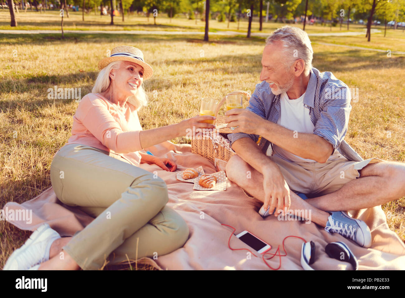 Relaxed retired couple going out for picnic - Stock Image