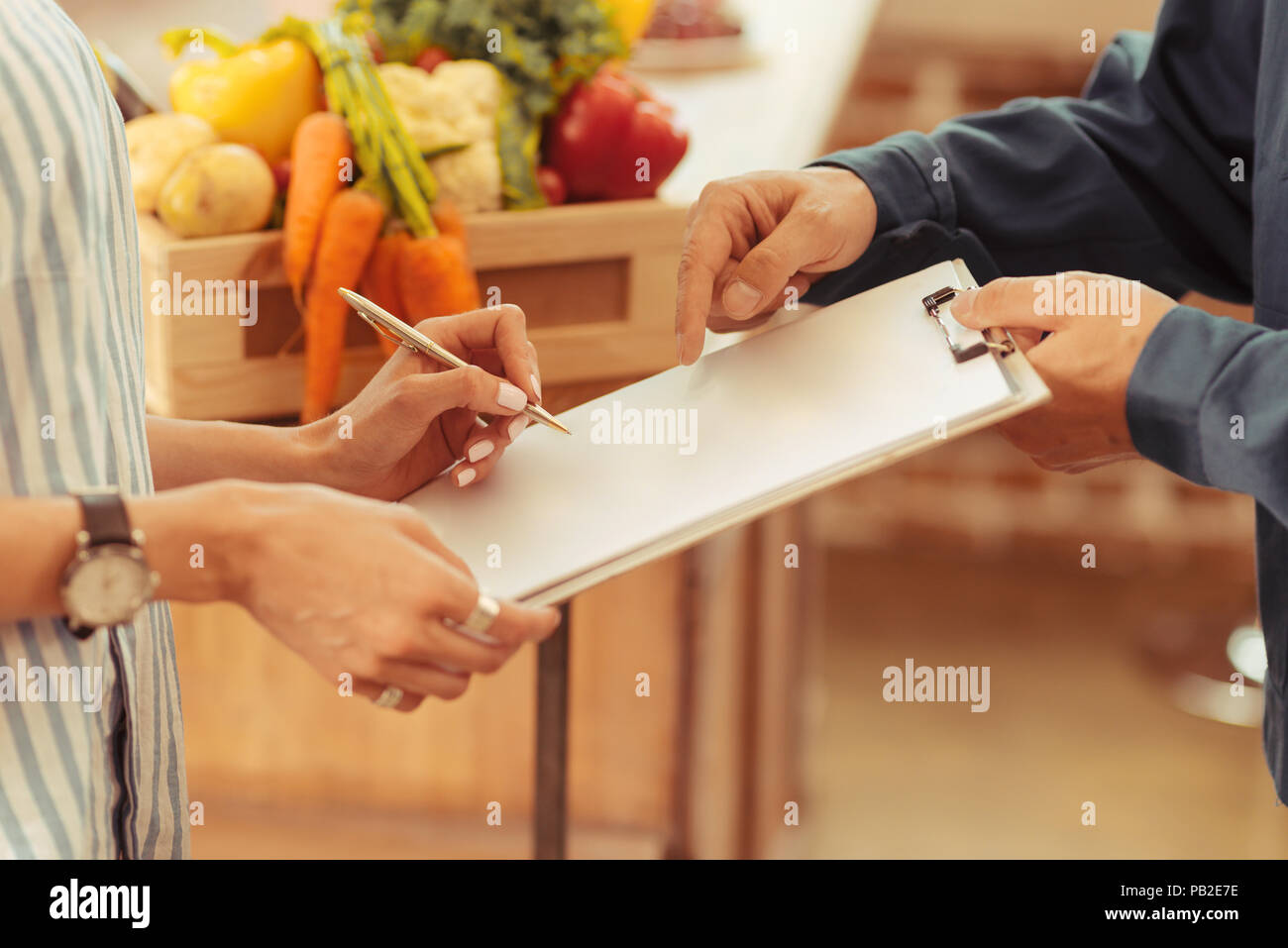 Close up of male hands that holding folder - Stock Image