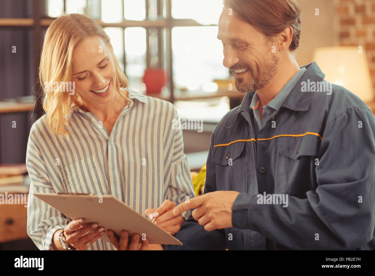 Attentive female person putting her sign - Stock Image