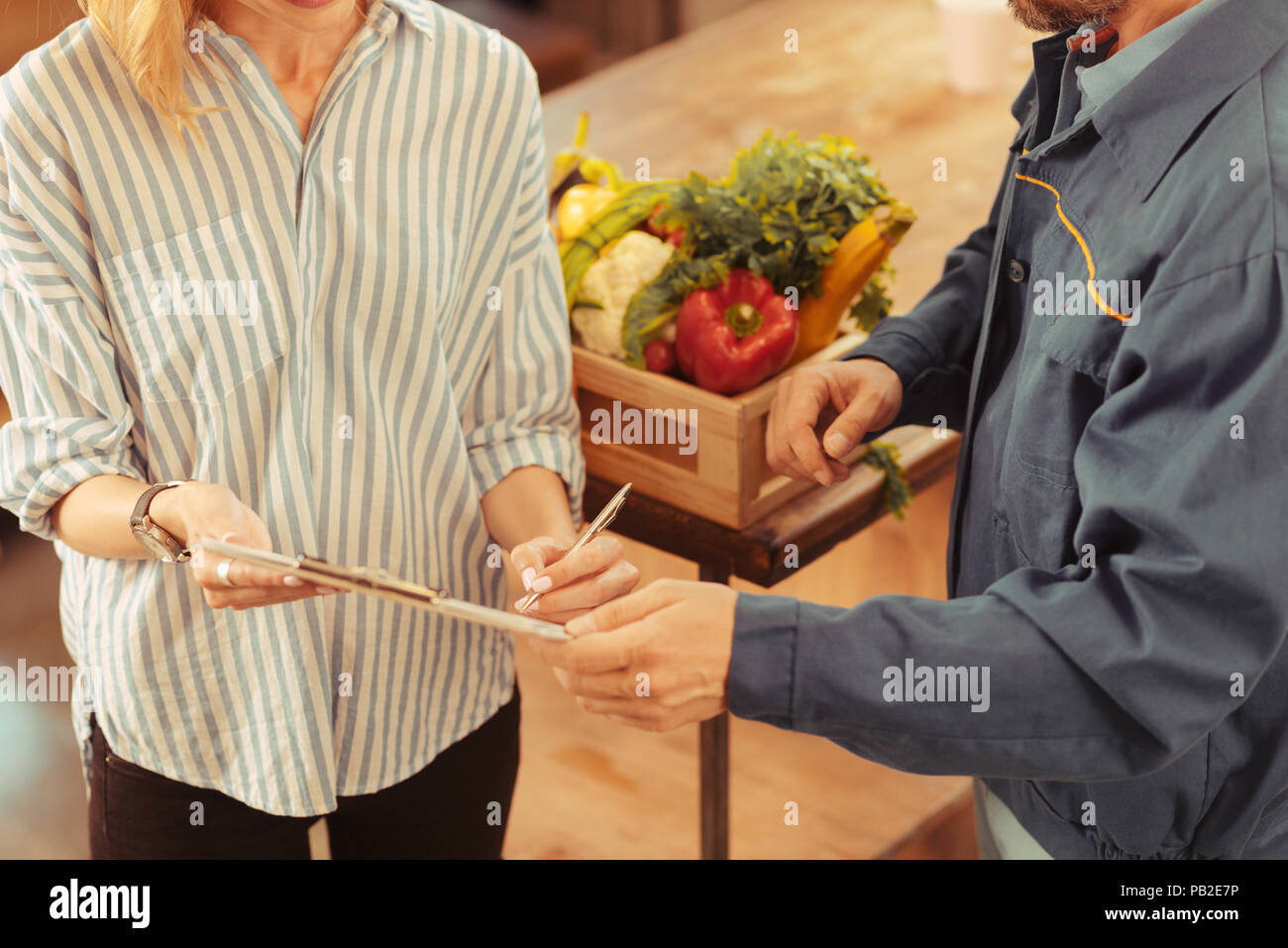 Top view photo of two people that holding folder - Stock Image