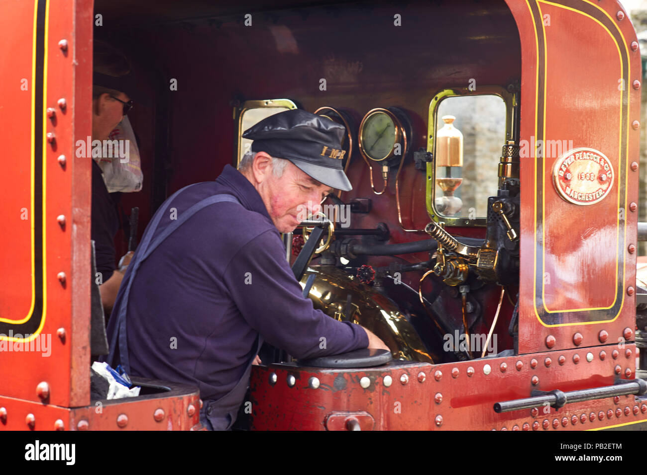 Isle of Man railways steam train driver in his cab at Port Erin station - Stock Image