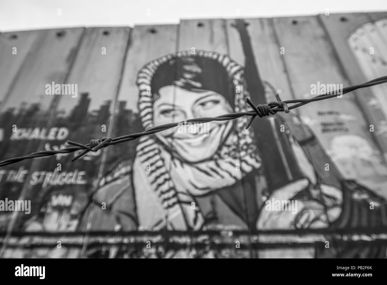 Jerusalem, Israel - separation barriers have been part of Palestine daily life in the last 20 years. Here in particular a painting on the wall - Stock Image