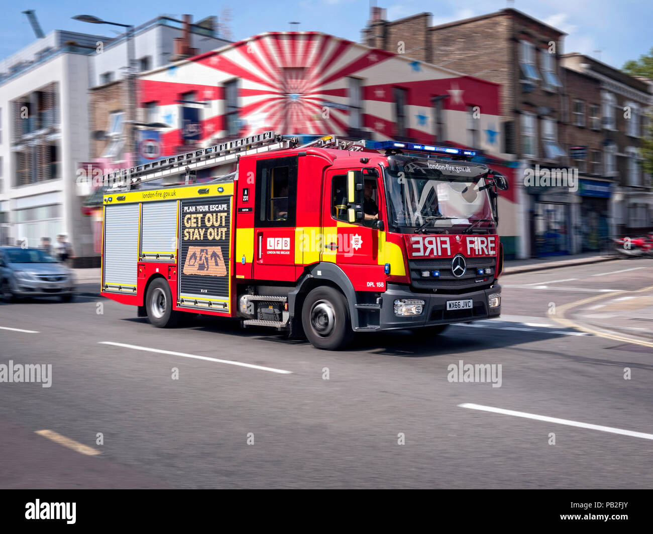 London Fire Brigade fire engine responding to an emergency call in Camden London UK - Stock Image