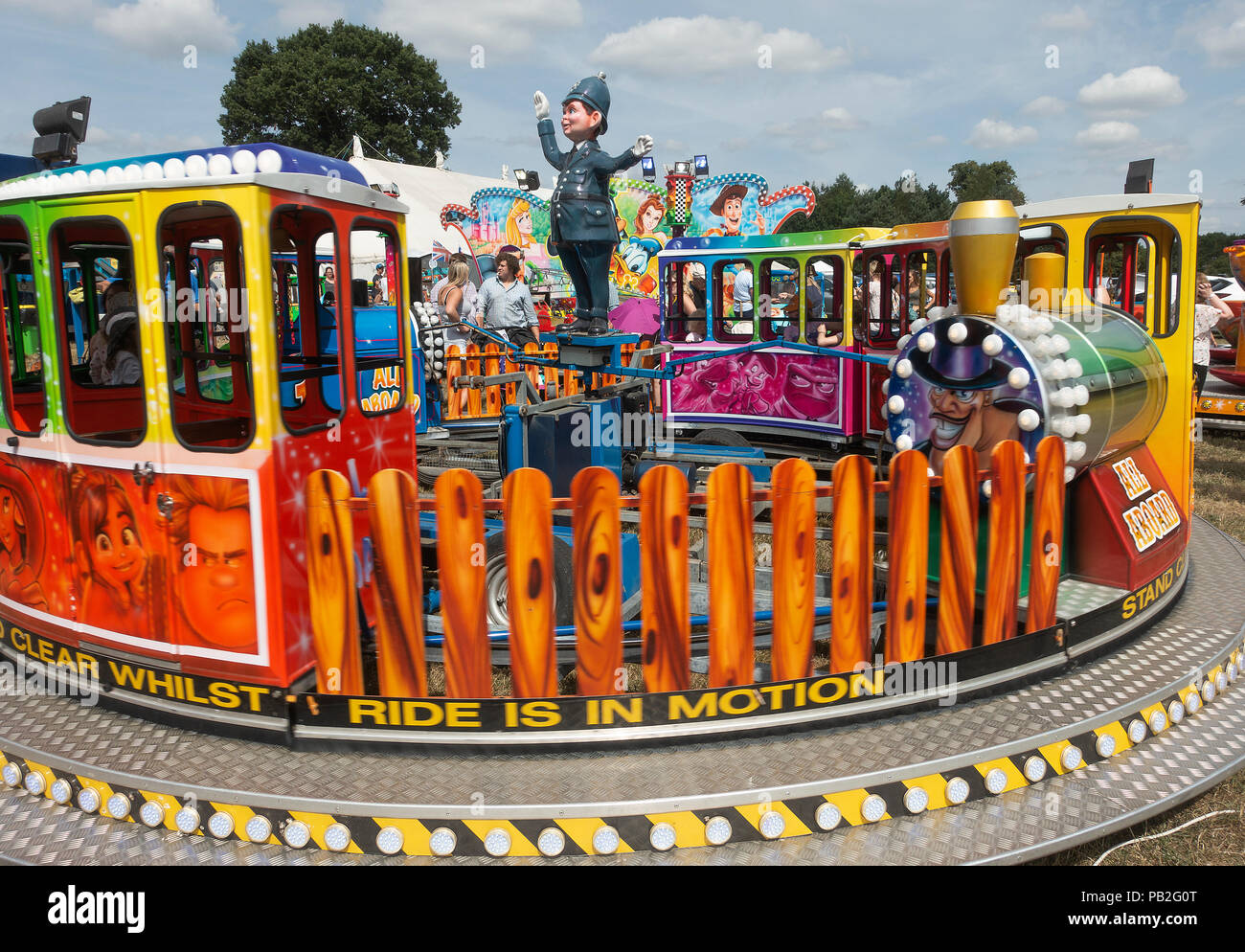 A Small Train Carousel or Roundabout for Child Rides at Nantwich Agricultural Show Cheshire England United Kingdom UK - Stock Image