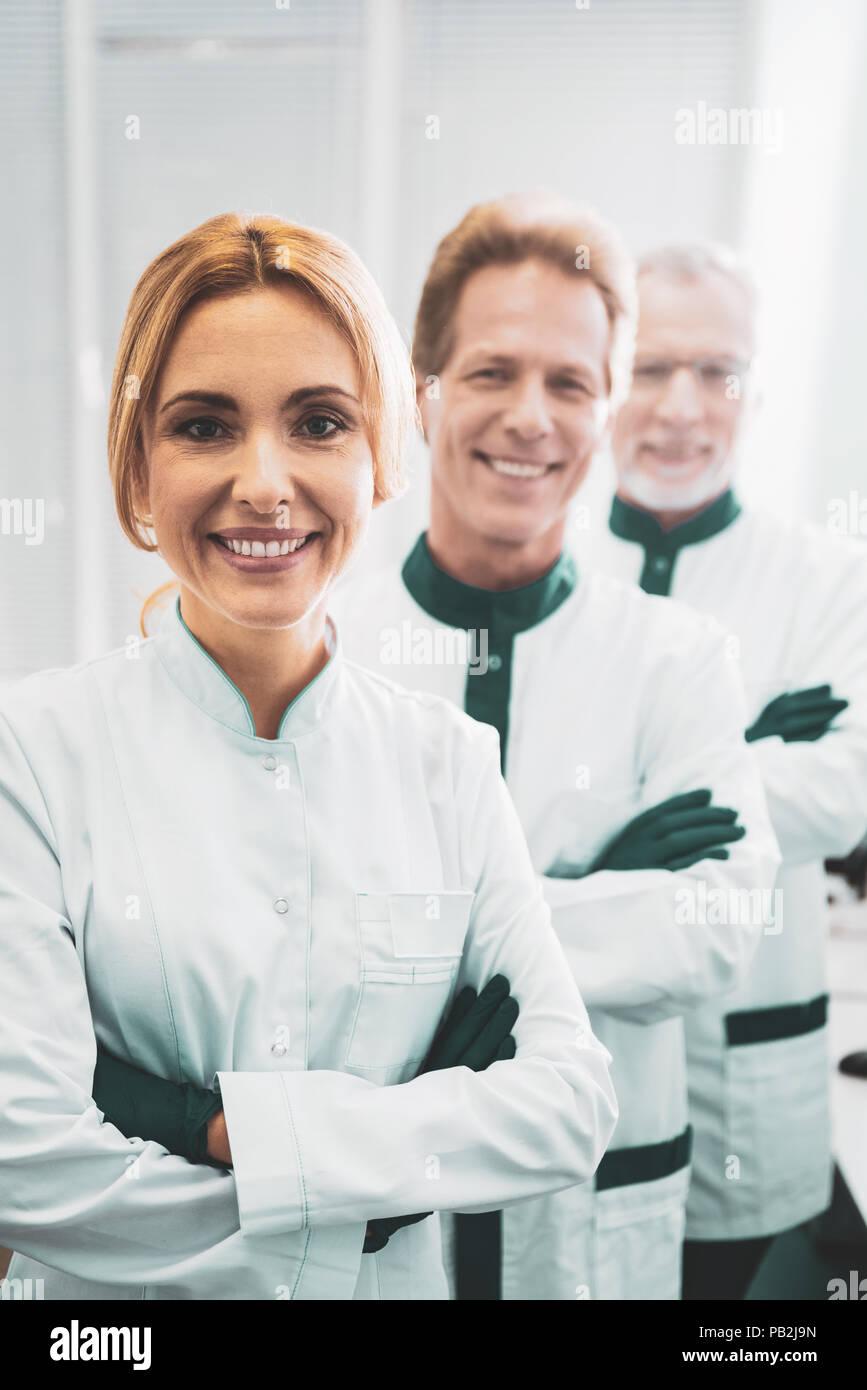 Chief blonde-haired bioengineer organizing staff meeting - Stock Image