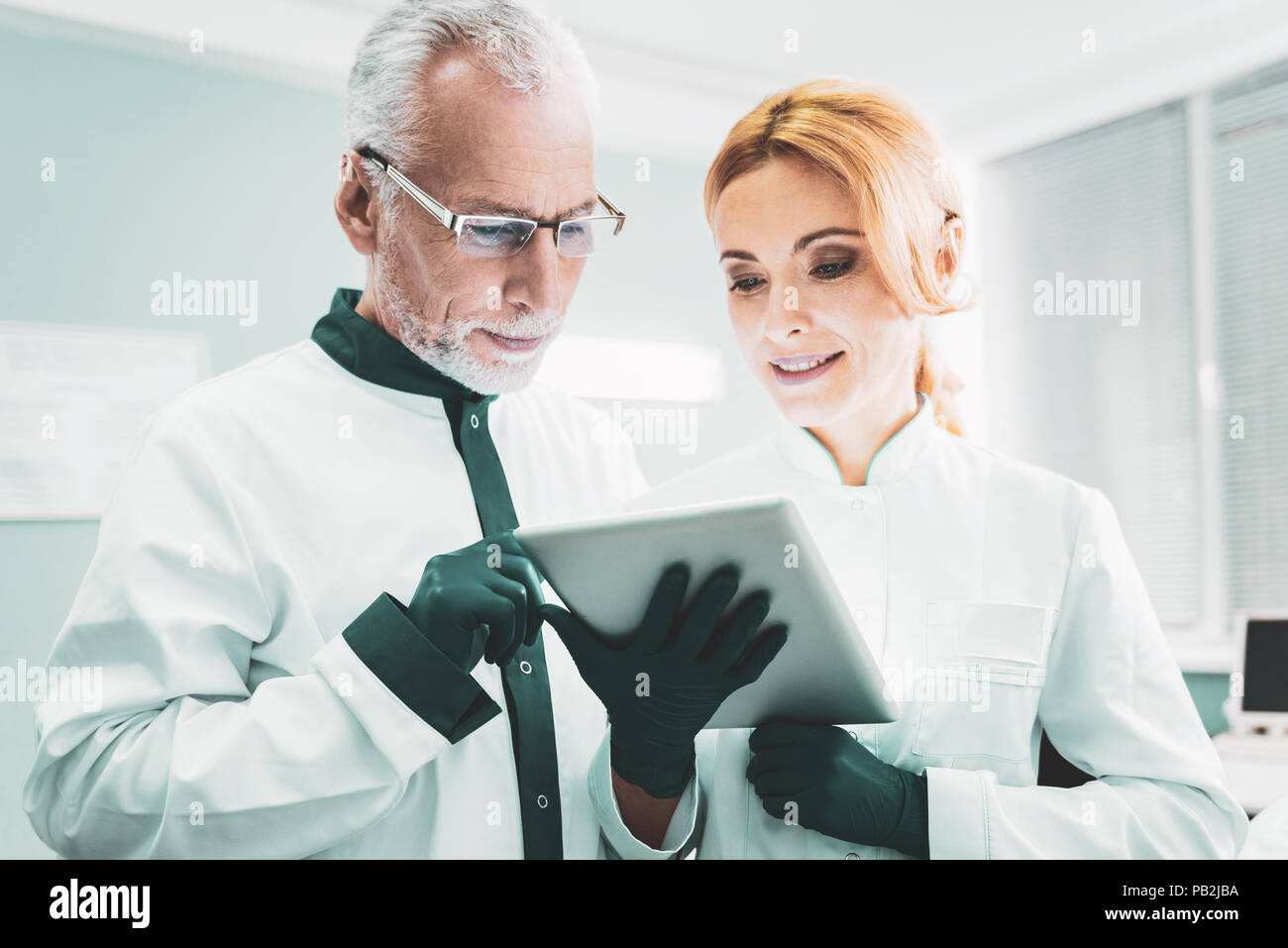 Two successful scientists checking the results of research - Stock Image