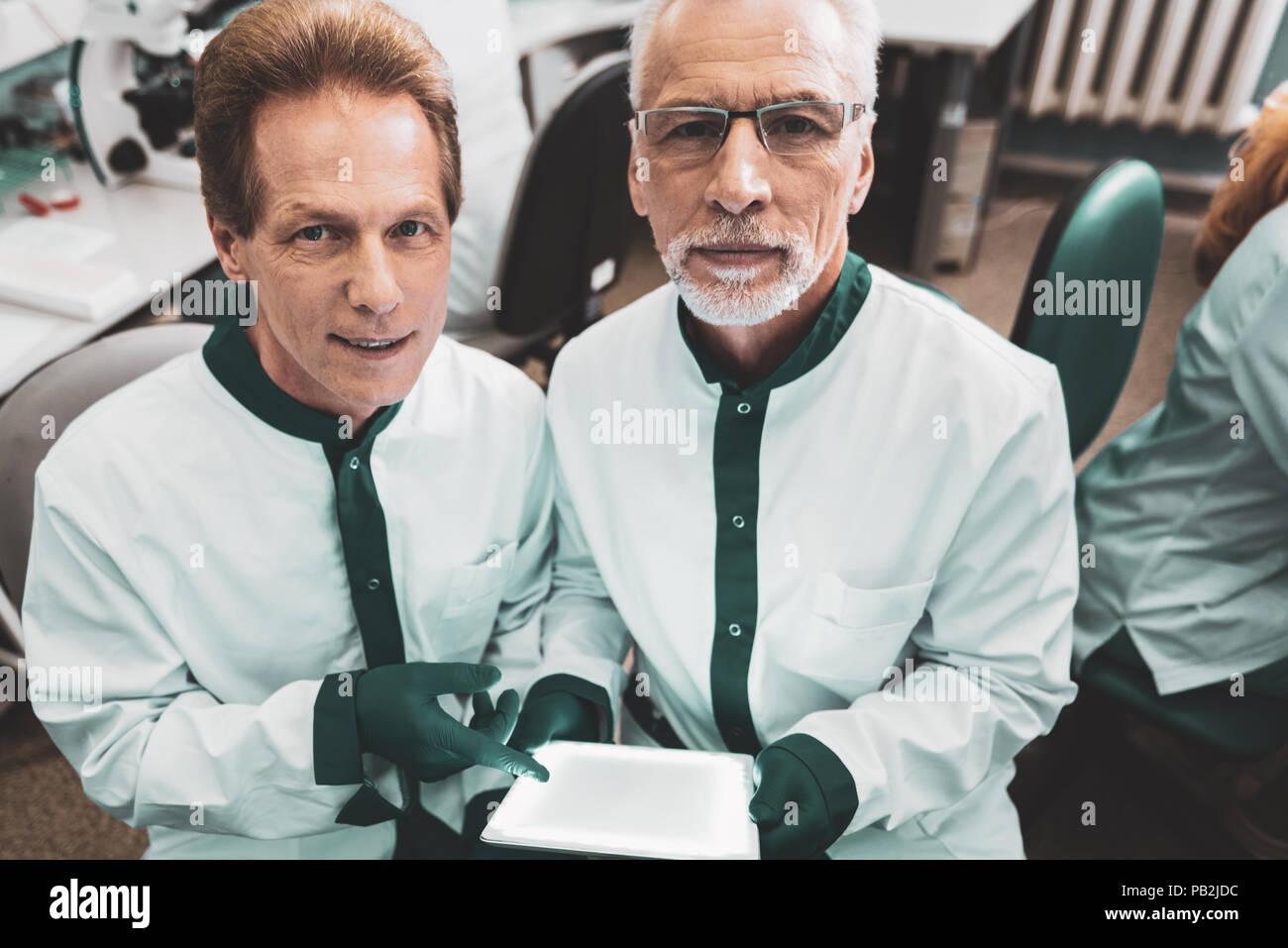 Elderly researchers feeling responsible making DNA test - Stock Image