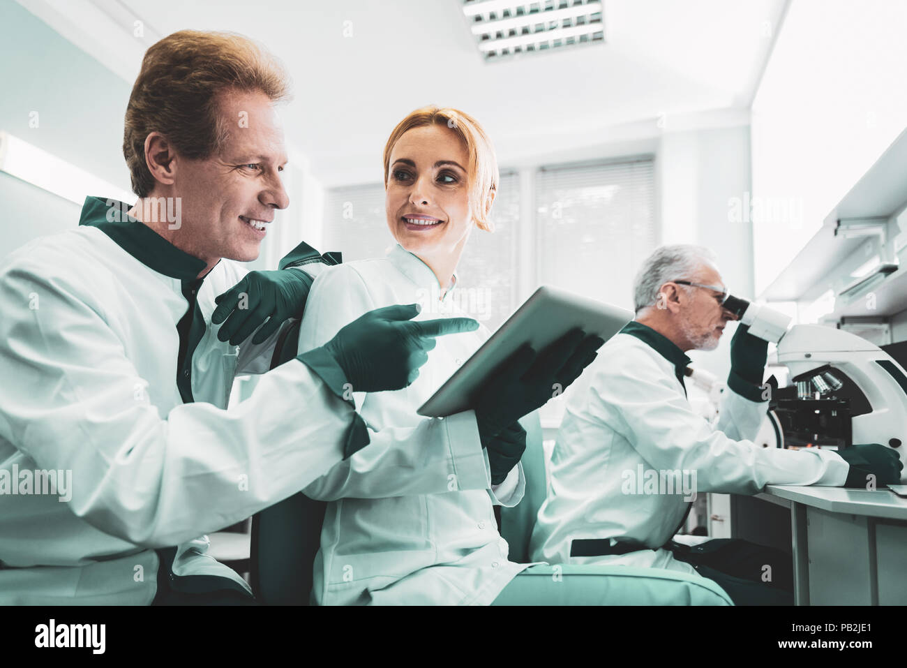 Professional technical engineer telling some news to his partner - Stock Image