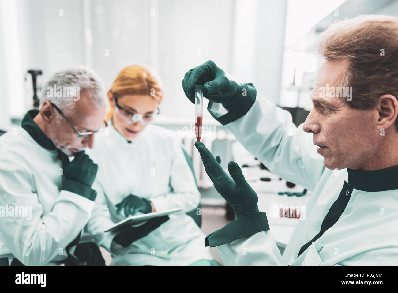 Famous chemist completing sensational discovery - Stock Image