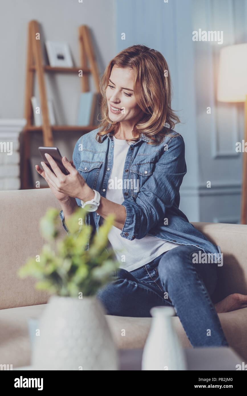 Happy financial advisor communicating online - Stock Image