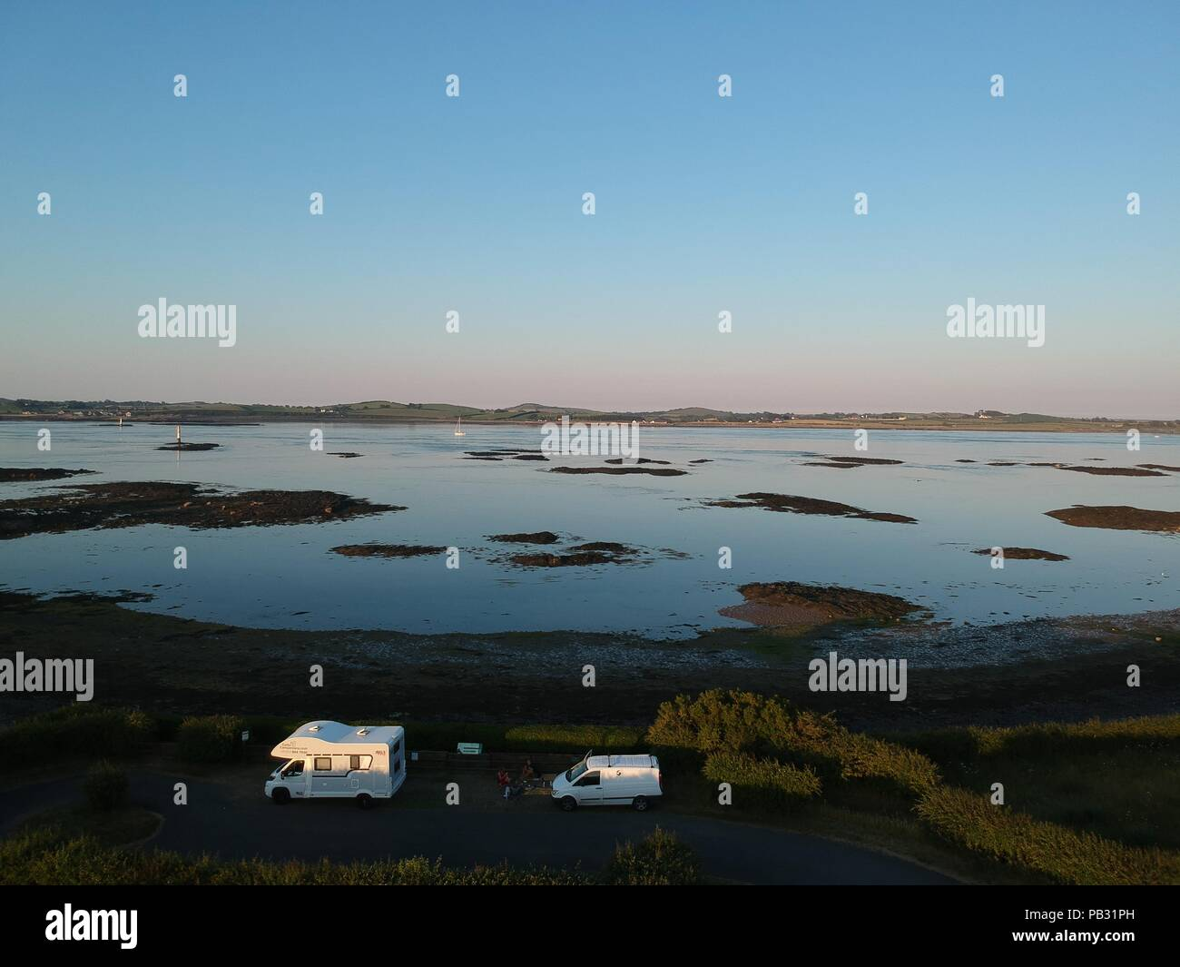 Campers by sunrise in Northern Ireland. Drone picture. - Stock Image