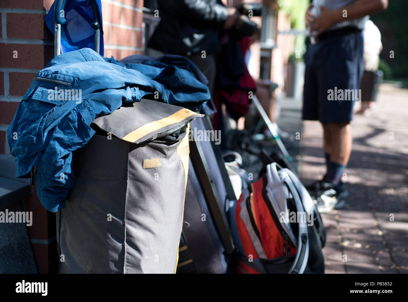 Munich, Germany  26th July, 2018  Homeless people stand with their