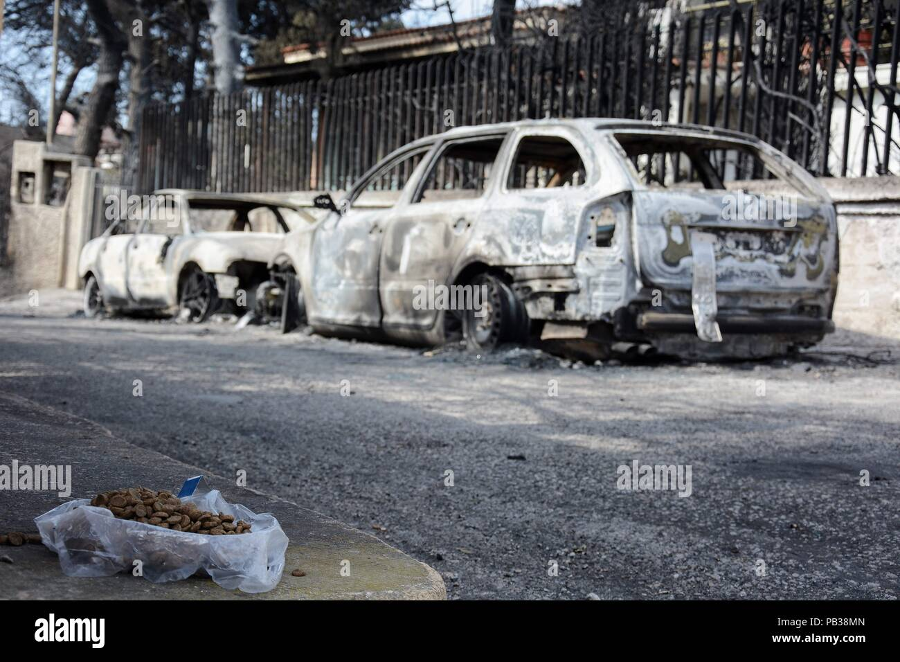 athens, greece. 26th july, 2018. burned cars seen in the area of the