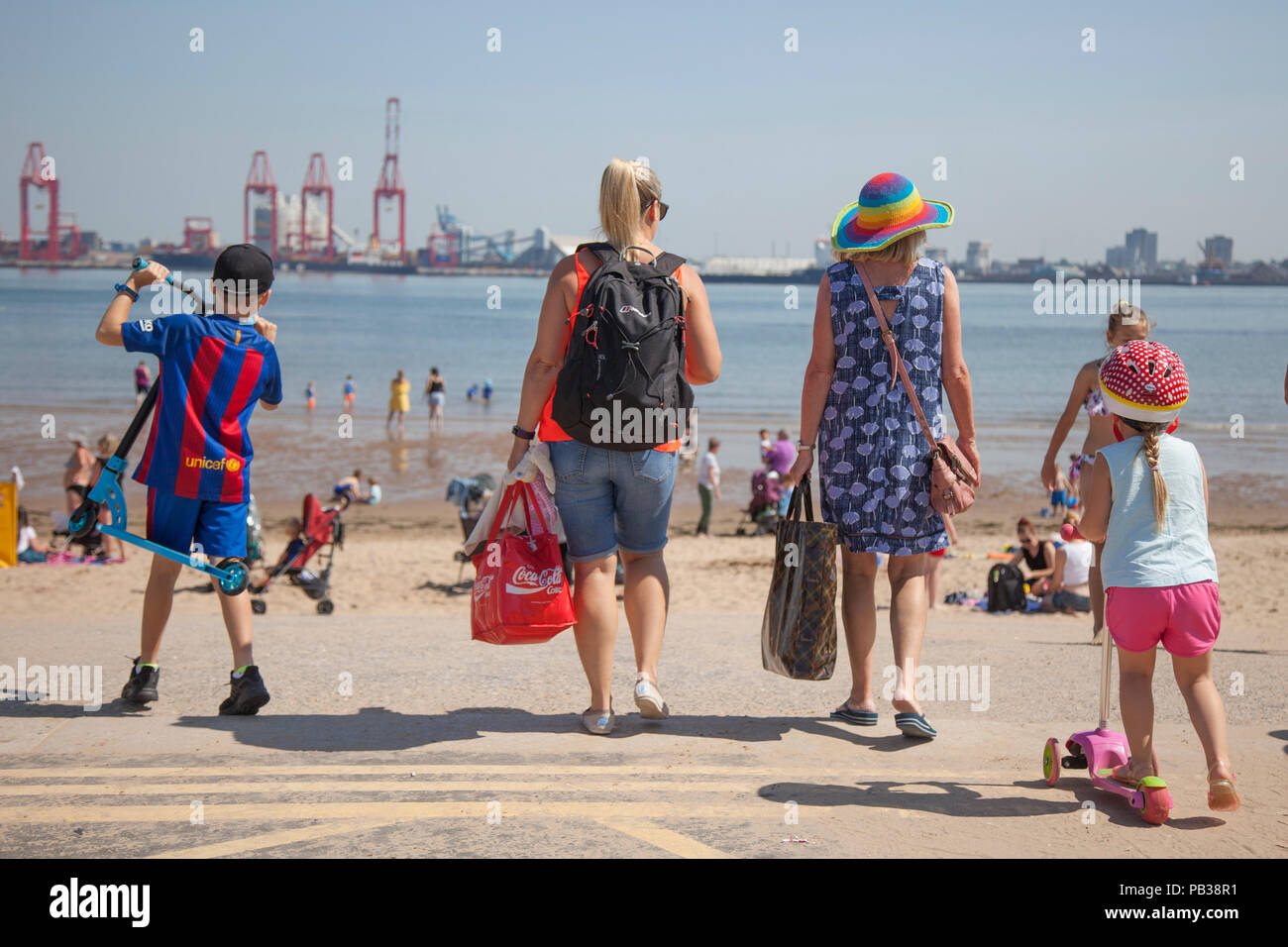 New Brighton, Wallasey.  UK Weather. 26/07/2018.  Crowds enjoy the summer sunshine in Seaside Resort Located on the Wallasey Coastline in the Wirral Peninsula. The development of New Brighton has been an undoubted success that is the jewel in the crown of Wirral's regeneration to date and is now a popular destination with throngs of visitors enjoying the beach particularly during the summer months. Credit: MediaWorldImages/AlamyLiveNews - Stock Image