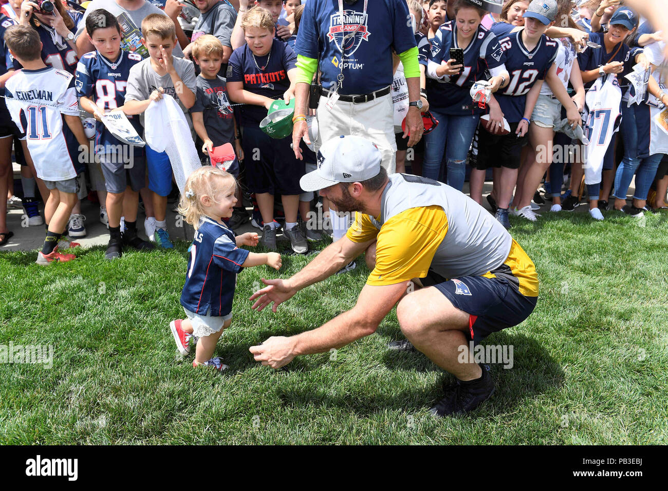 Foxborough, Massachusetts, USA. 26th July, 2018. New England Patriots wide receiver Julian Edelman (11) is greeted by his 20 month old daughter Lily Edelman at the New England Patriots training camp held on the practice fields at Gillette Stadium, in Foxborough, Massachusetts. Eric Canha/CSM/Alamy Live News - Stock Image