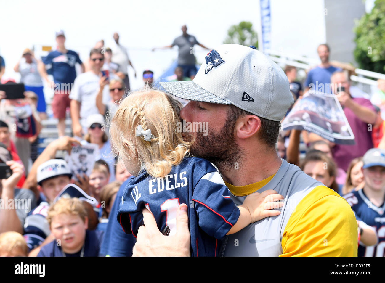Foxborough, Massachusetts, USA. 26th July, 2018. New England Patriots wide receiver Julian Edelman (11) give his 20 month old daughter Lily Edelman a kiss at the New England Patriots training camp held on the practice fields at Gillette Stadium, in Foxborough, Massachusetts. Eric Canha/CSM/Alamy Live News - Stock Image
