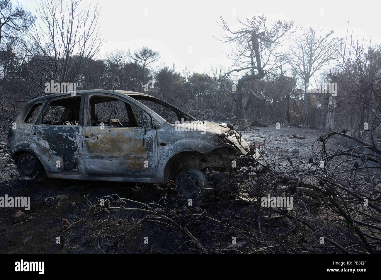 athens, greece. 26th july, 2018. burned car seen in the area of the