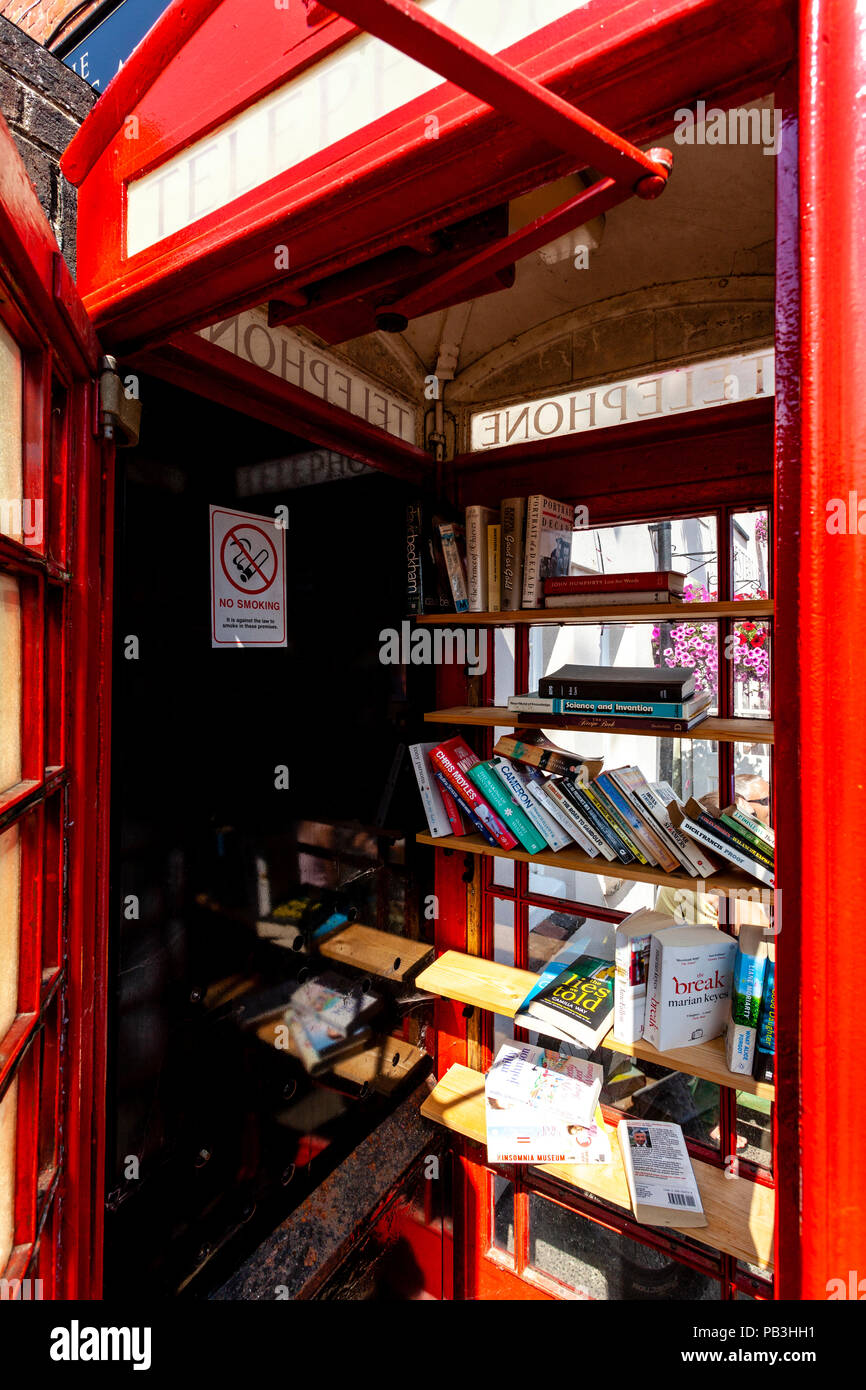 A Traditional Red Telephone Box Converted To A Village Library, Fairwarp, Sussex, UK - Stock Image