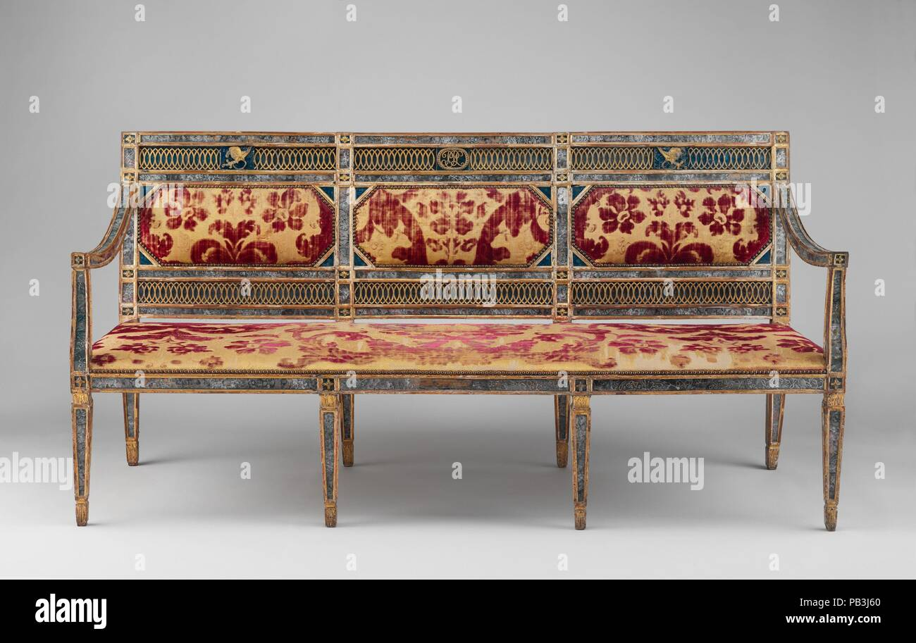 Triple-back settee (part of a set). Culture: Italian, Sicily. Dimensions: Overall: 38 3/4 × 78 3/8 × 26 in. (98.4 × 199.1 × 66 cm). Date: ca. 1790-1800.  This settee is from a large set of seat furniture, which included at least four settees and twenty side chairs. It was formerly thought to have been commissioned for the Villa Palagonia at Bagheria near Palermo, but the provenance remains undocumented, and the initials in the cipher at the center of the back, 'PPL,' are as yet unidentified. The reverse-painted glass panels in imitation of agate, lapis, and marble are a distinctive feature oft - Stock Image