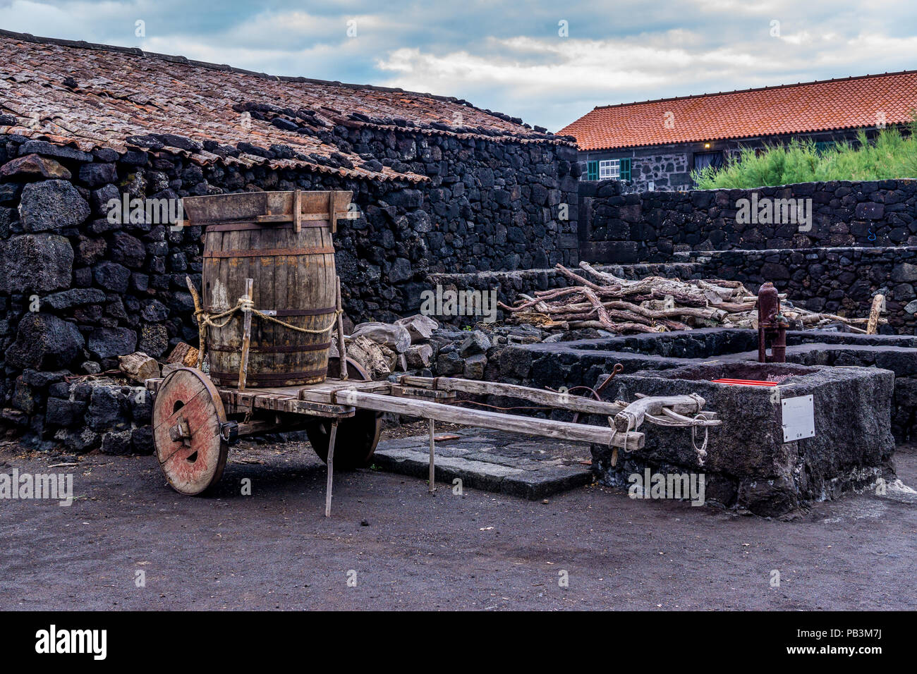 Wine barrel on a cart, near the Lajido Vineyard Culture Interpretation Centre on Pico Island, Azores - Stock Image