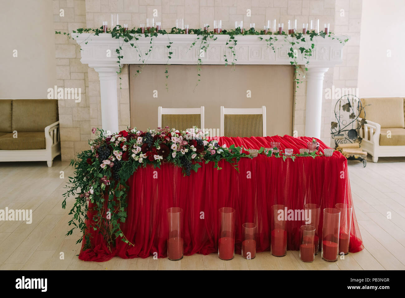 The bright red cloth on a wedding table. Magnificent wedding presidium - Stock Image