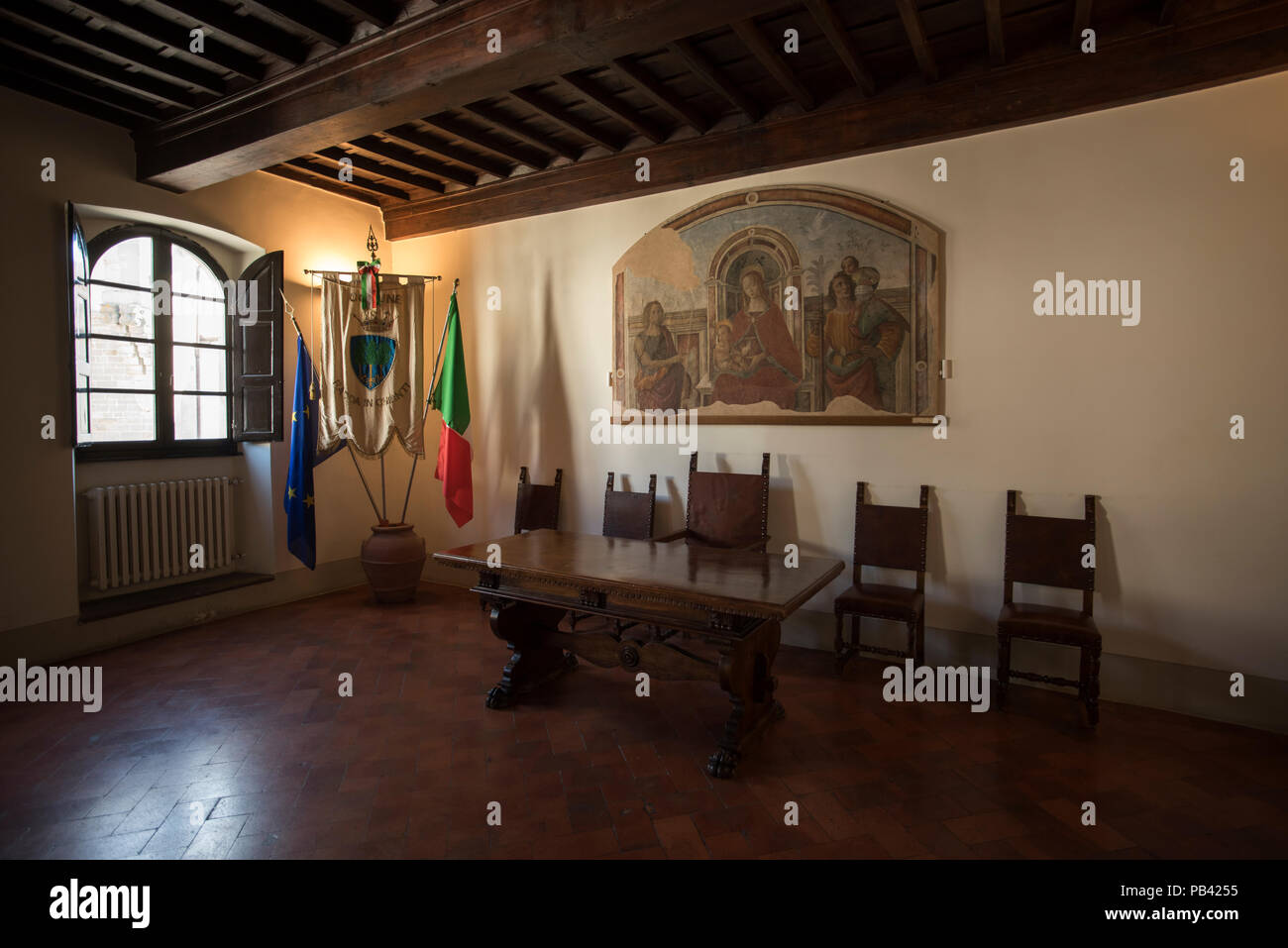 Radda in Chianti, Tuscany Italy. June 2018 Palazzo del Podestà interior showing local council chamber with Italian flags. - Stock Image
