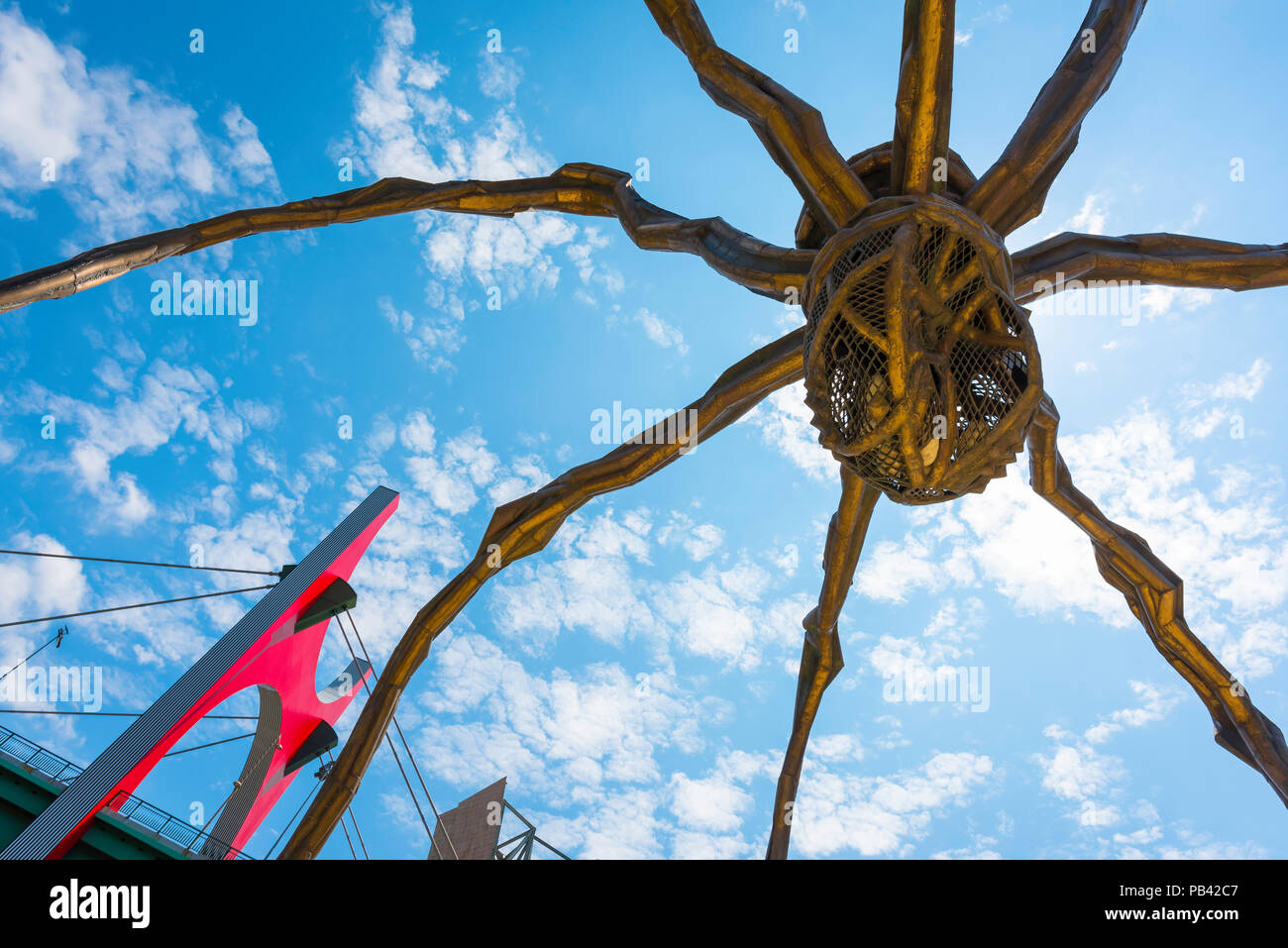 Bilbao Spain city, view of the underside of the Louise Bourgeois designed huge bronze spider (Maman) beside the Guggenheim Museum in Bilbao, Spain. - Stock Image