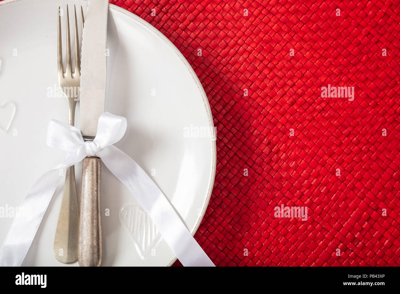 Valentines Day Dinner Table Place Setting On Red Background Copy