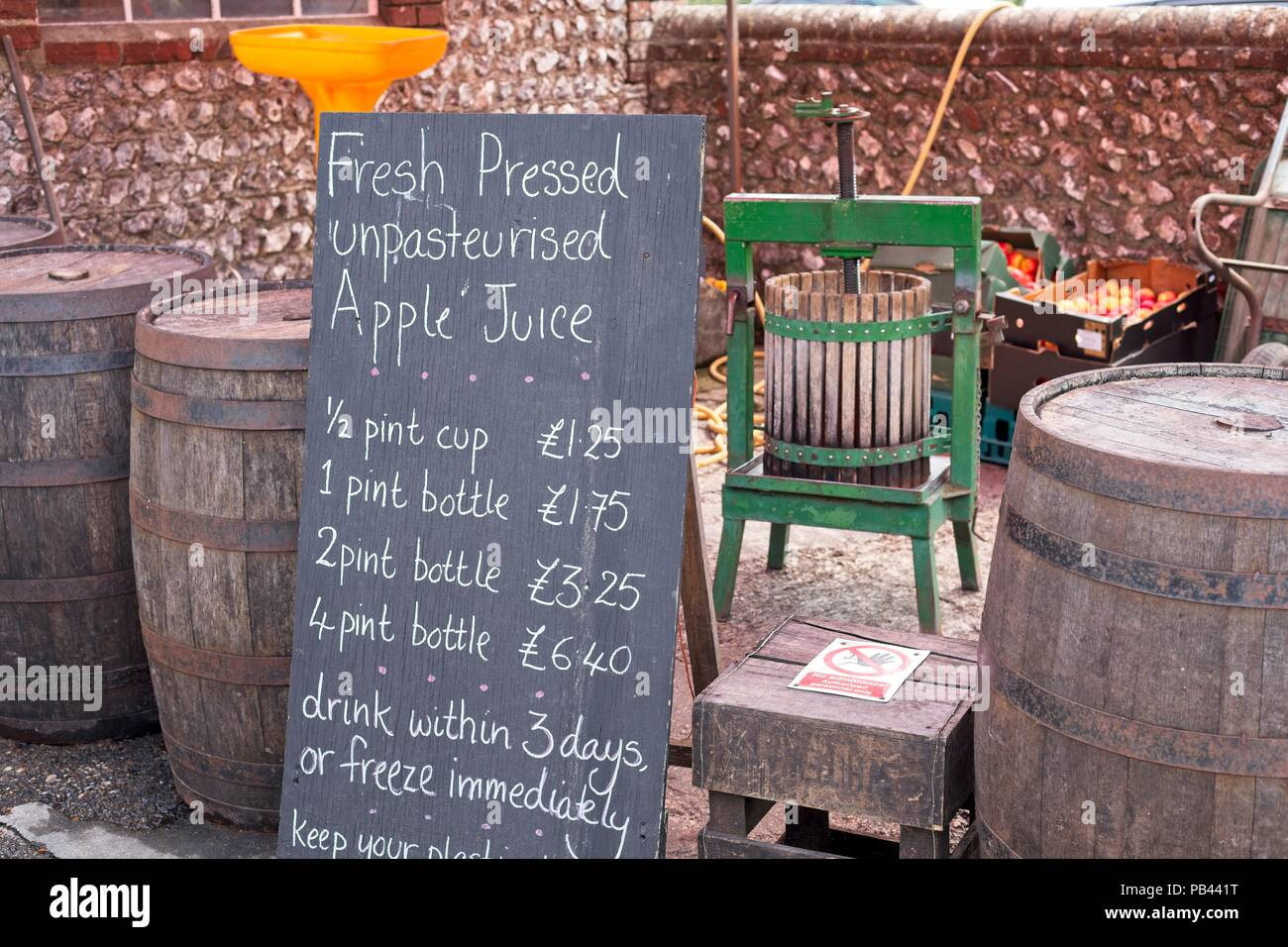 Fresh pressed apple juice for sale in Middle Farm shop, Sussex, UK - Stock Image