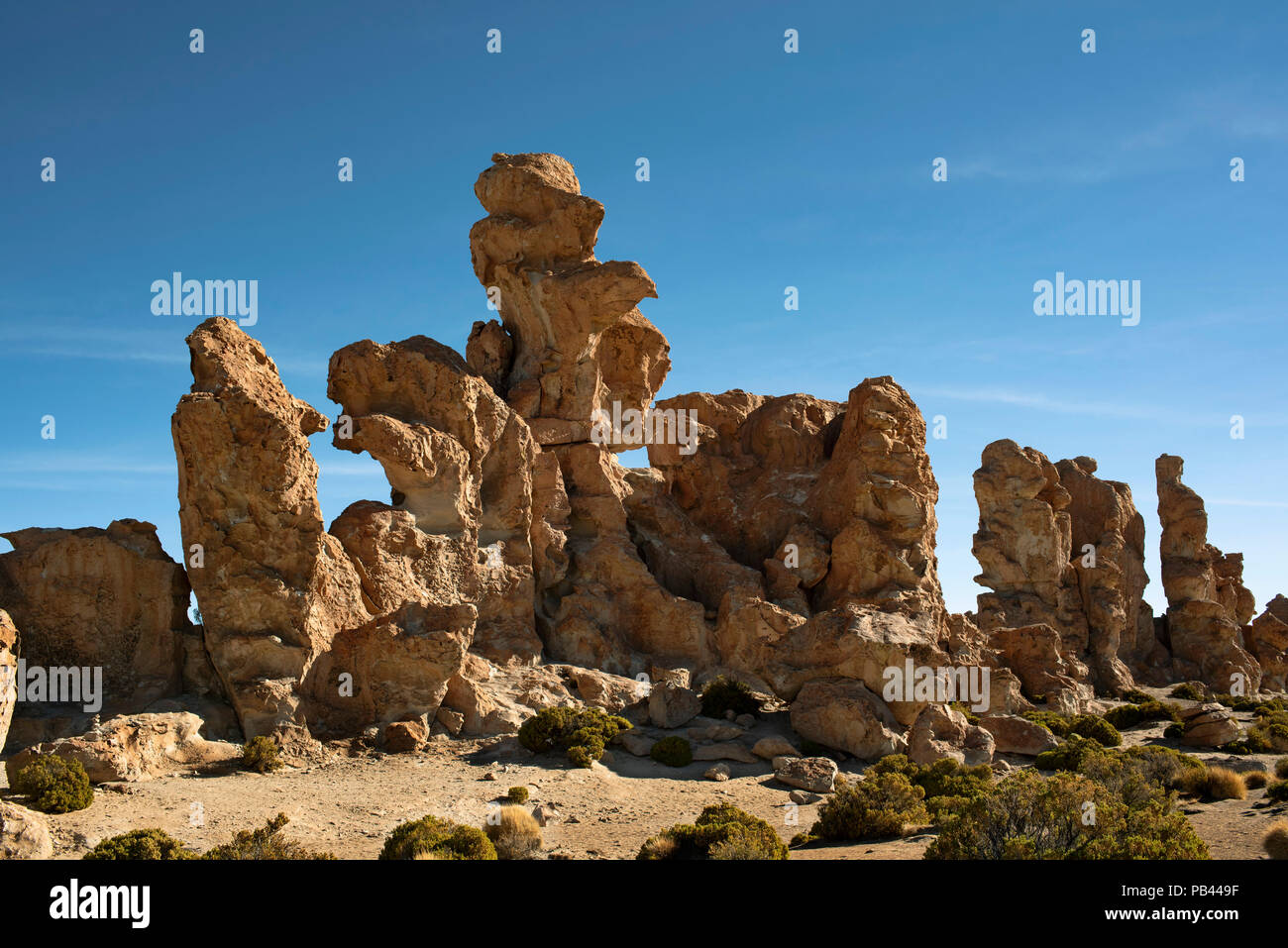 Interesting and spectacular group of bright orange rocks shaped by wind erosion. Valle de Rocas (Valley of the Rocks). Bolivia, South America. - Stock Image