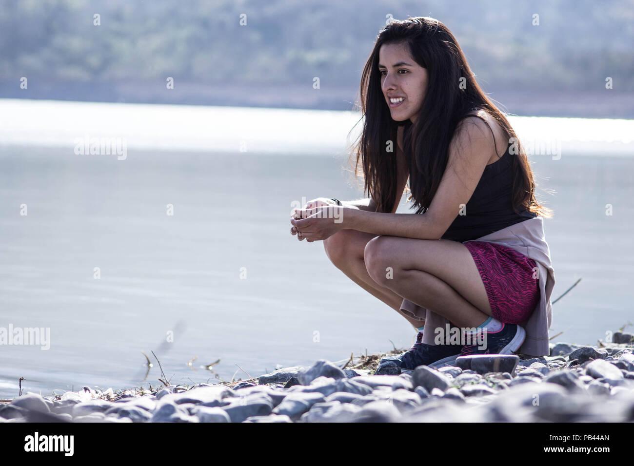 girl possing in lake - Stock Image