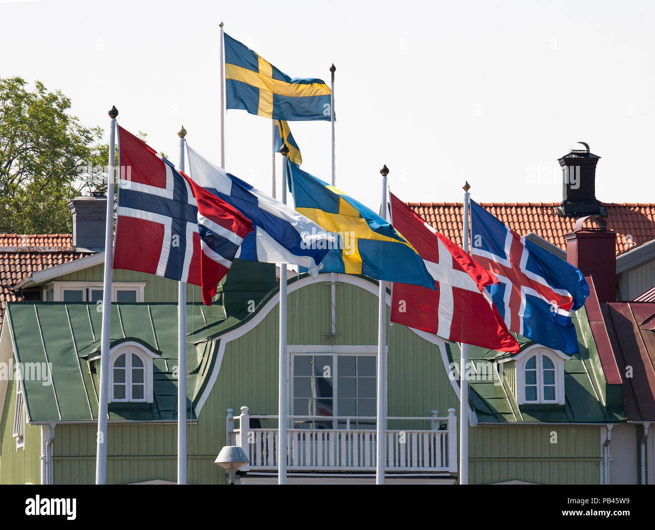 NORDIC FLAG on pole,Norway,Finland,Sweden,Denmark and Iceland 2018 - Stock Image