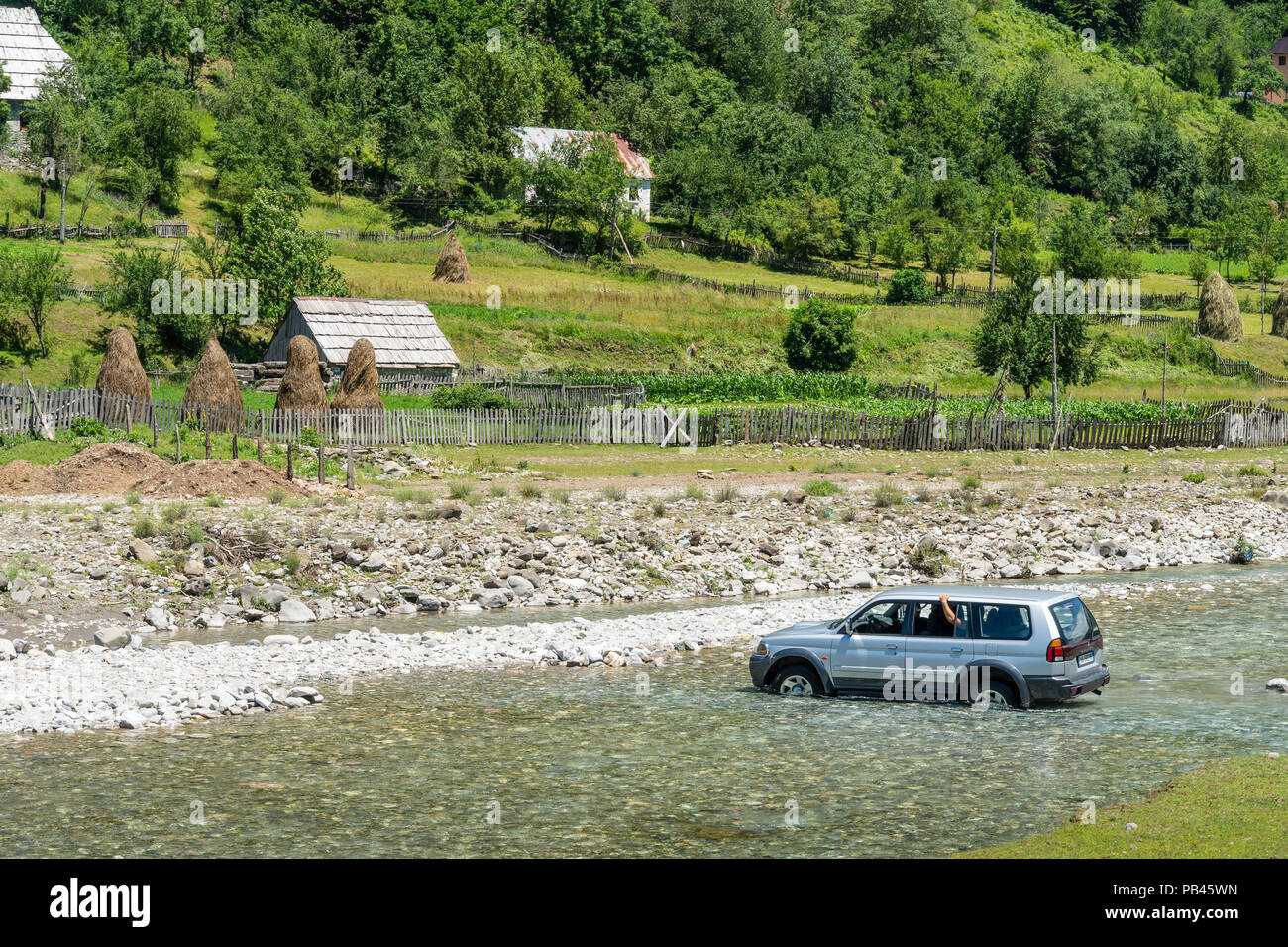 A car fording the river Grencars in Vermosh, the most northerly village in Albania, just below the border with Montinegro.  Albania. - Stock Image