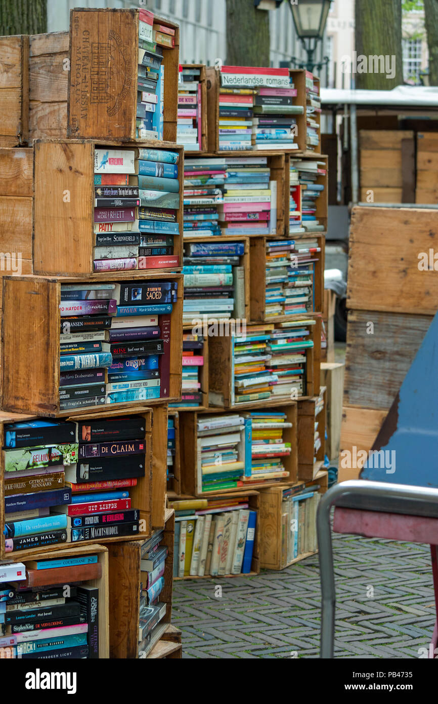 Fiction and novel books uniquely on display for sale at a book market. - Stock Image