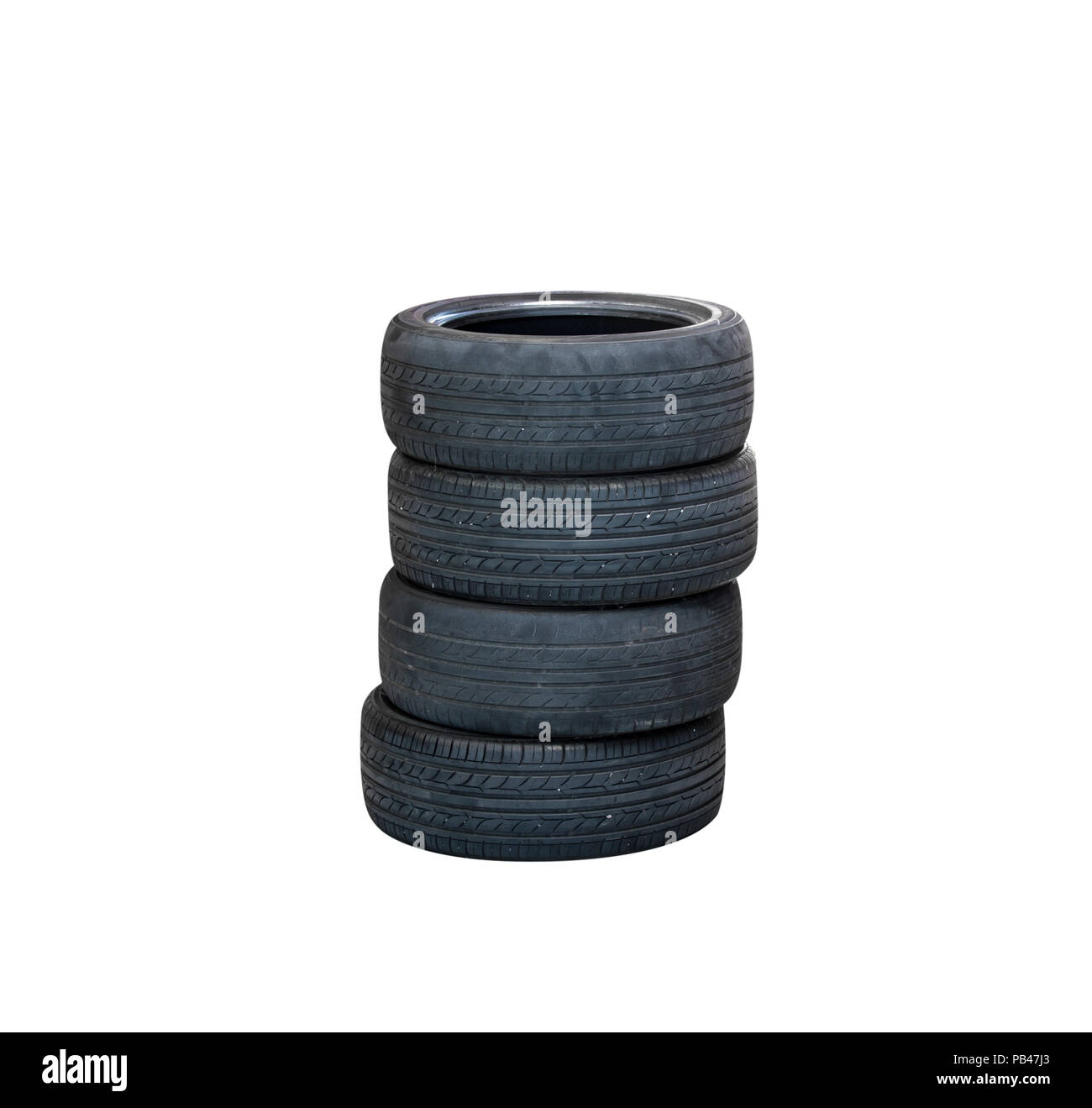 Old tires stacked, isolated on white background - Stock Image