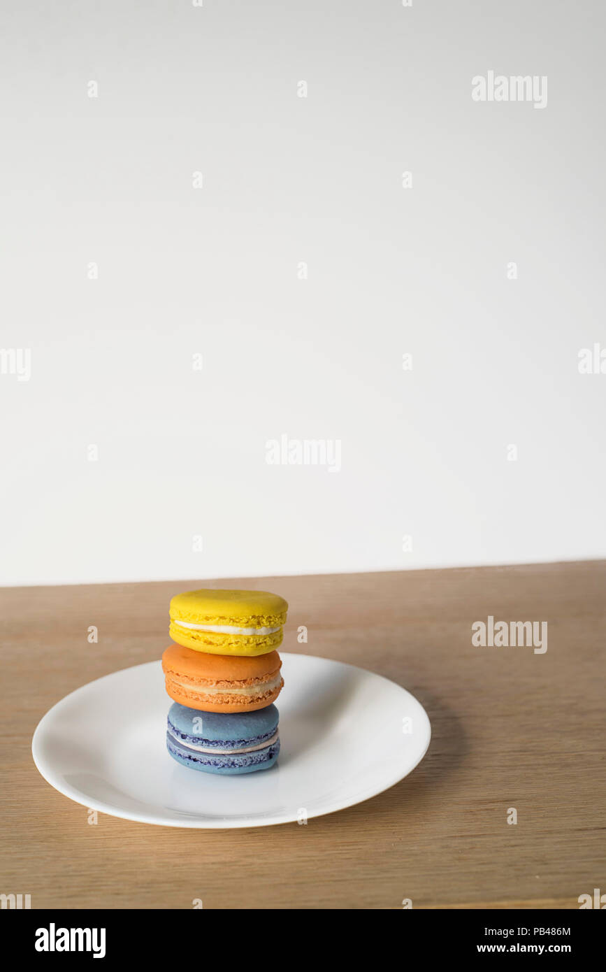 Macarons Set of Three Sitting in Bright Sun on a Minimal Background - Stock Image