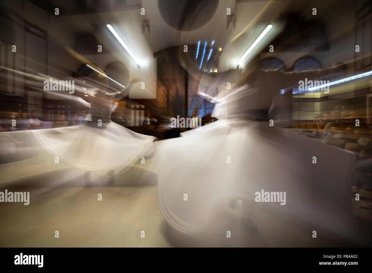 Dancers, whirling dervishes ceremony, Sirkeci Train Station, Istanbul, Turkey - Stock Image