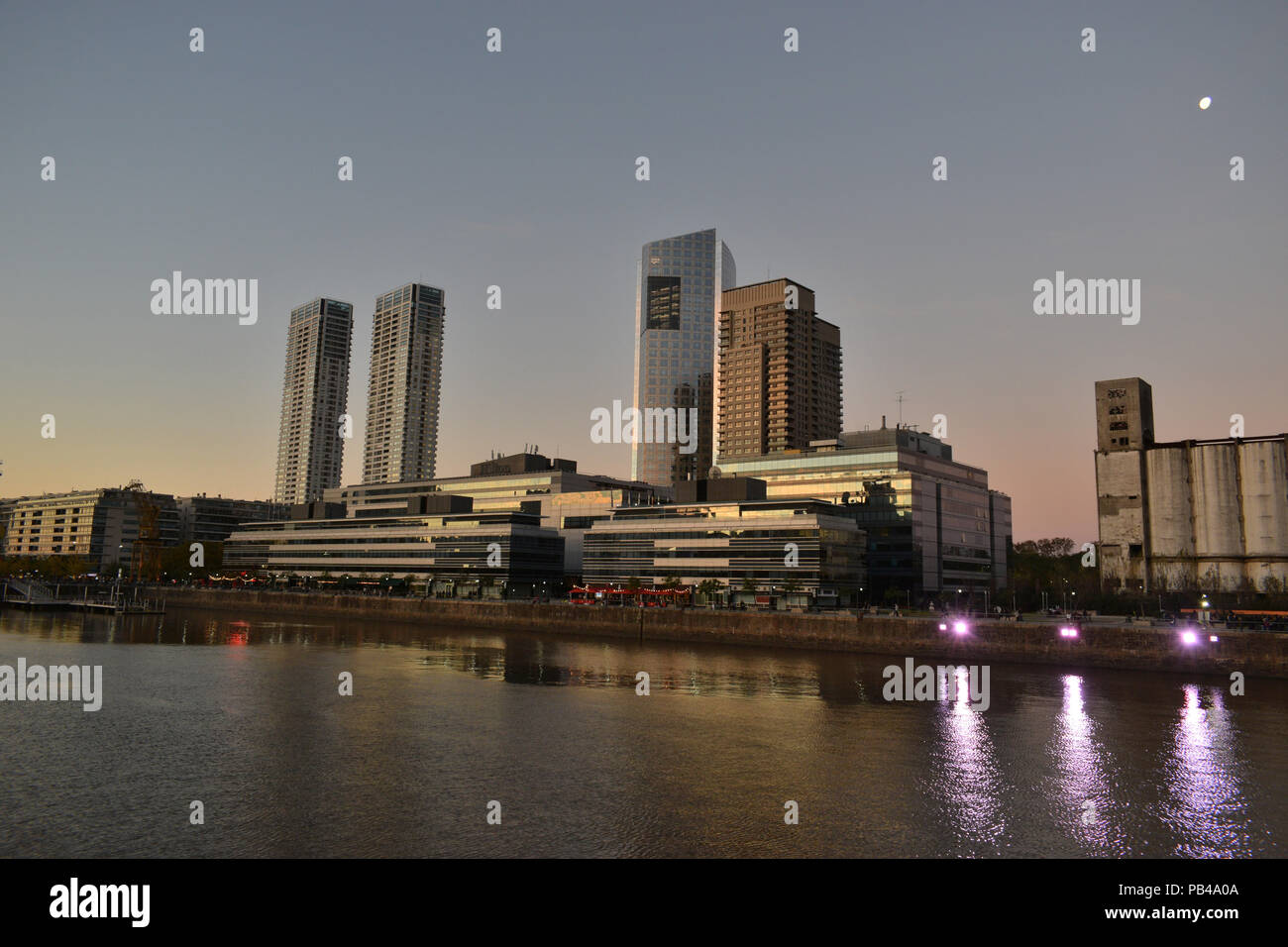 harbour and skyline of Puerto Madero at sunset, Buenos Aires, Argentina - Stock Image