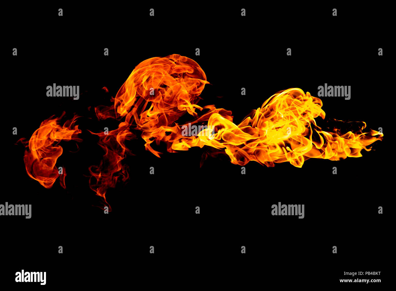 Burning flame isolated on a black background. Fire in red, orange and yellow. Horizontal orientation image. - Stock Image