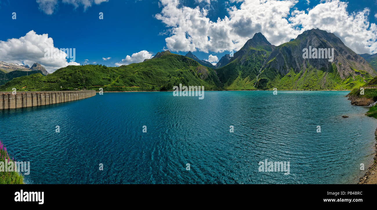 Landscape on the lake of Morasco in summer season with blue sky and clouds in background, Formazza valley - Piedmont, Italy - Stock Image