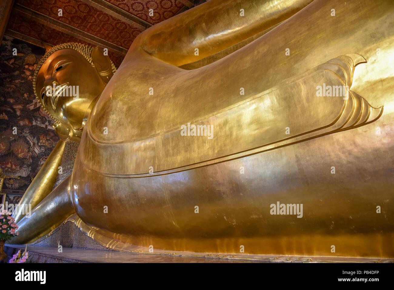 Big golden reclining Buddha of Wat Pho temple in Bangkok, Thailand. - Stock Image