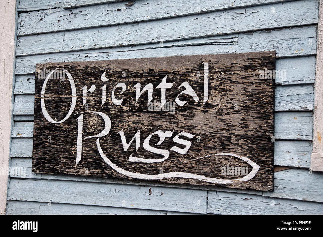 Sign outside a store selling rugs in Woolwich, Maine - Stock Image