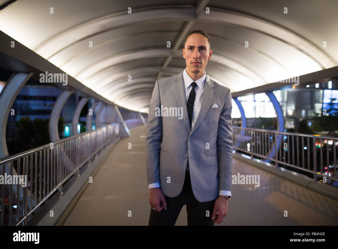 Young Handsome Businessman Outdoors At Night - Stock Image