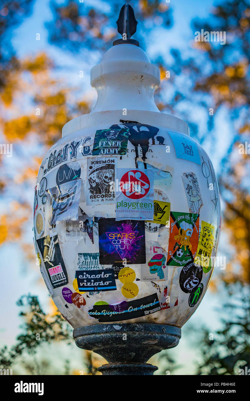 BARCELONA, SPAIN - 13 JANUARY 2018:The glass lamp on the street of Barcelona is pasted with advertising posters - Stock Image