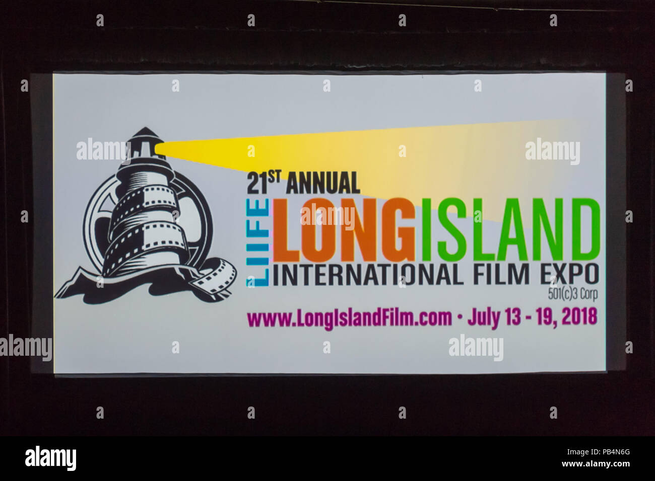 Bellmore, New York, USA. July 18, 2018. At start of final block of film screenings for the 21st Annual LIIFE Long Island International Film Expo, the LIIFE lighthouse and film reel logo and information fill the screen at the Bellmore Movies, the LIIFE location. LIIFE is a nonprofit 501(c)3 Corporation. Stock Photo