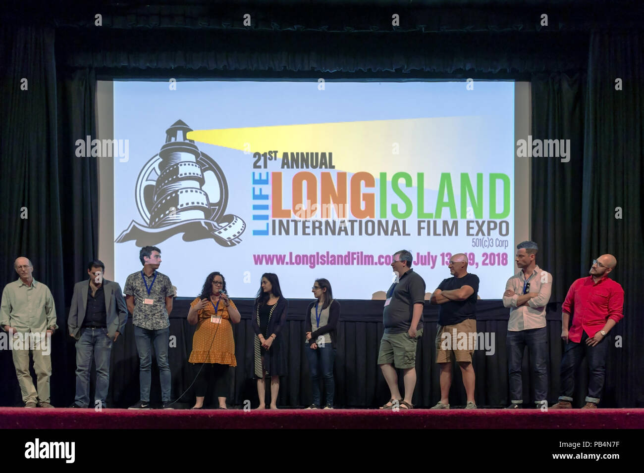 Bellmore, New York, USA. July 18, 2018. After final block of film screenings at LIIFE 2018, the Long Island International Film Expo, filmmakers and actors go on stage for Q&A at Bellmore Movies. SHARA ASHLEY ZEIGER, speaking into mic, is producer and writer of romcom short film JOE; right of her are AJNA JAI, who plays title character in The Adventures of Penny Patterson; and STEPHANIE DONNELLY, writer and director of that film. Stock Photo